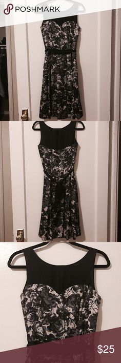 "Beautiful Black Floral H&M Dress Size 6 This a beautiful formal/cocktail dress from H&M. Black upper with a sweetheart neckline, with a black floral design on a pale pink-gray background. Satin/glossy finish. Polyester. Approximately 41"" from shoulder to hem. H&M Dresses Midi"