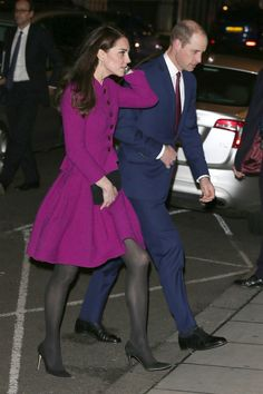 The Duchess of Cambridge wears an Oscar de la Renta purple skirt suit, black tights, black pumps and a clutch while attending theGuild of Health Writers Conference with Prince William.