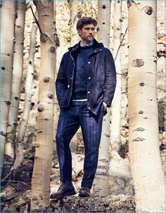 A smart casual combination of a navy blue wool parka and navy striped dress pants can maintain its relevance in many different circumstances. Complement this look with dark brown leather casual boots.   Shop this look on Lookastic: https://lookastic.com/men/looks/parka-cable-sweater-dress-shirt/21759   — Light Blue Dress Shirt  — Navy Cable Sweater  — Navy Wool Parka  — Navy Vertical Striped Dress Pants  — Dark Brown Leather Casual Boots