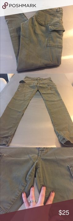 Olive skinny cargo pants Very cute and trendy. Pre loved. Purchased from Nordstrom. Has slight mark on each leg, pointed out in picture. Size 1, fits like size 25. Brand is ST Blue. Pants Skinny