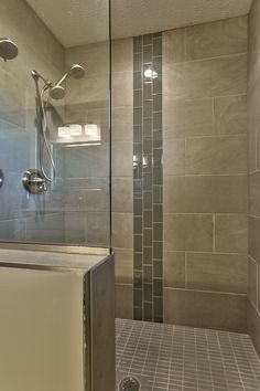 Partially encased showers allow for spacious relaxation and rejuvenation, especially on a cold Omaha night! Refresh in a BlueStone Custom Builders shower! #BlueStoneHomes #OmahaHomeBuilders #ShowerEnvy #TiledShower