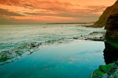 Sunrise at Newcastle Bogie hole. This is the oldest man made rock pool in Australia built by convicts.