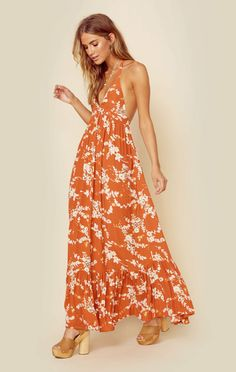 """This romantic maxi dress from Kivari features a plunging neckline with halter tie closures, allover floral print, and an effortless flowing body style. ImportedDry Clean Only100% RayonFit Guide:Model is 5ft 8 inches; Bust: 34"""", Waist: 25"""", Hips: 36""""Model is wearing a size XSRelaxed FitShoes Featured Not Available For Purchase"""