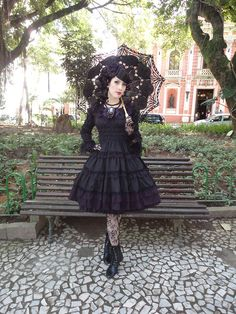 dark beauty, love the dress and hair