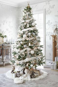 white Christmas tree decorated flocked holidays feathers