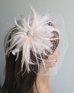Beautiful fascinator and vail made separately. Approx. 7 in diameter Veil is 28 x 9 Please feel free to ask me any questions or special requests. I have many other clips available. I have designed & created each piece in my shop All pieces are securely wrapped & boxed to prevent damage/breakage  FREE USA SHIPPING on orders of $200 or more!  Thank you very much for stopping by at my shop Have a great day