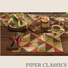 The Indian Summer collection by Park Designs features a warm, harvest-inspired palette of brown, cream, sap green, barn red, and gold tones in a patchwork pattern. The rich colors complement a variety of dinnerware styles. Great for fall or everyday offering a casual yet sophisticated look!    Indian Summer Placemat reverses to barn red windowpane check. Measures 13 x 19 inches. 100% cotton. Machine wash, cool delicate cycle, line dry. www.piperclassics.com