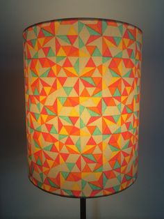 Candy colored triangles. 20cm drum shade. Handcrafted by lampelier