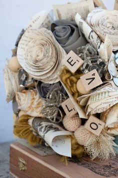 very cool, yet untraditional bouquet...i'd put the letters in a bit differently though...
