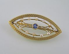 A Yellow Gold Almond Shaped Art Deco-late by SummitJewelers