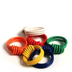 wow, these bring back memories...the telephone man once gave me and my friend a huge bundle of wire pieces, we made a million of those rings!