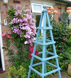 Simple obelisk with clematis and roses