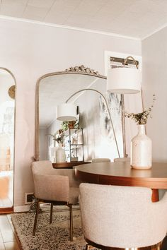 Lovely living room with Gleaming Primrose Mirror from Anthropologie.