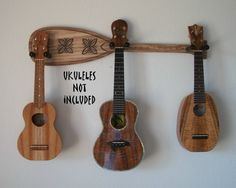 Ukulele wall mount hanger, hand carved, boat paddle shaped, holds 3.