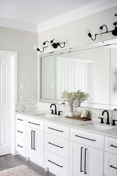 Shop rooms designed by top designers and purchase home decor products for your home. - Scout & Nimble These modern black vanity sconces pop so well against the all white back drop! Large mirror over a double vanity with white cabinetry and black hardware Bathroom Layout, Modern Bathroom Design, Bathroom Interior Design, Decor Interior Design, Bathroom Ideas, Bath Ideas, Tile Layout, Minimal Bathroom, Bath Design