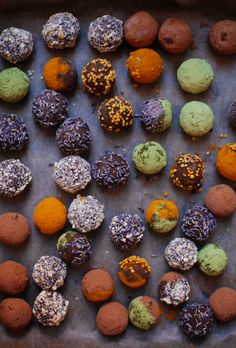 Easy vegan chocolate truffles, which get their decadence and creaminess from sweet potato and raw cacao powder, coated with all-natural superfood sprinkles.