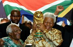 Nelson Mandela, right, with Archbishop Desmond Tutu, in Zurich in 2004 after South Africa was named the host for the 2010 soccer World Cup