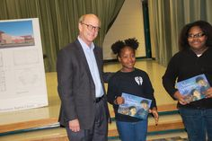 Architect Fred Reed of Pine Bluff with students who received brand new Winter in Songming books donated by Heifer International