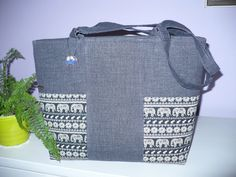 Dark hangbag with elephant pattern