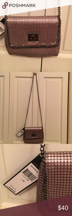 Fabulous BCBG NWT METAL gold toned bag. BCBG NWT fantastic gold metal type purse. It will sparkle for the holidays!!!! I love this purse! BCBGMaxAzria Bags Crossbody Bags