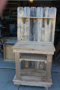 Potting bench from recycled fencing and cedar paneling.