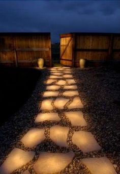 Another great way to light up a path: Literally, light up your pathway with that same glow-in-the-dark paint! Simply spray paint your path. This picture is so cool. Almost looks like a painting.