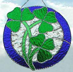"3 Shamrocks with Blue Border - Stained Glass Suncatcher - 9 1/2"" x 10"" - $39.95--- Celtic Designs, Irish Designs, Irish Sun Catchers - Glass Suncatchers, Stained Glass Décor, Stained Glass Sun Catchers -  Stained Glass Design - See more stained glass designs at www.AccentonGlass.com"