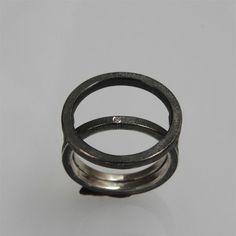 Minimalistic contemporary stacking ring in door andreasschiffler