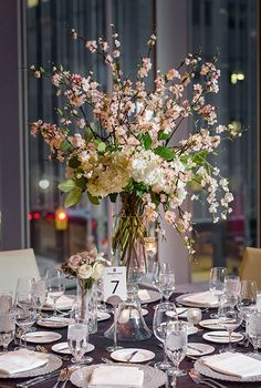 Uniquely elegant blush and white floral wedding reception centerpiece; Featured Photographer: Curio Studios, Via Rebecca Chan Weddings & Events