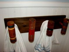 towel rack using croquet mallets as hooks