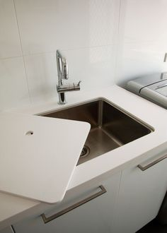 Fitted sink cover for laundry, increases bench space