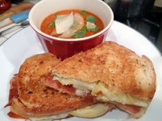 Roasted Tomato Bisque served with a Prosciutto and Artichoke Heart sammy. The kicker in this sammy is the roasted lemon aioli, swiss and gruyere cheese on rye bread! Super good!