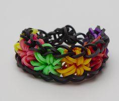 Rainbow starburst! #kidsjewelry #rubberbandbracelets #kidscrafts #bracelets #rainbow #loom