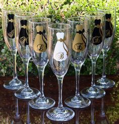 Elegant black and gold champagne flutes for the wedding party.