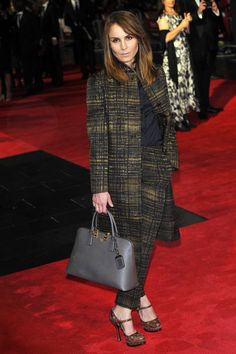 2. Actress Noomi Rapace is sharp in a tweed suit. Check out her grey Prada bag - to die for!