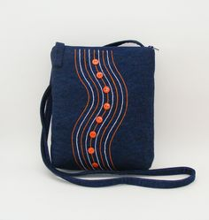 Blue denim cross body bag orange and white buttons