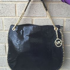 Michael kors black handbag Absolutely stunning authentic MK bag with goldtone hardware . Comes with MK booklet .  Chealsea Black Embossed Leather. Top is zip closure and also there is a Button Closure Pocket to side of Top Opening of Purse  Inside Purse there are 4 slip pockets and 1 zip pocket. Straps are adjustable . Carry it one long strap or pull both on together and carry with shorter straps MICHAEL Michael Kors Bags Shoulder Bags