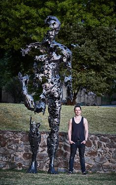 "Regardt van der Meulen South-African born sculptor. | ""I am just the pieces"" 4m tall male figure steel sculpture"