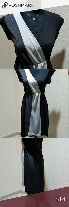 "Rhapsody hi-lo color block dress Cute hi-lo blavk and gray dress. The bodice has a wrap design, waist has elastic, skirt drapes nicely. Length 34"" front back 41"". Bust - 16"", waist - 13"" flat. Rhapsody  Dresses High Low"