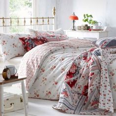 i love how layered all the different bedspreads look together