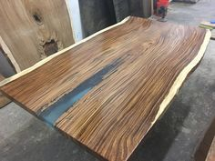 This Parota Blue is a true piece of art. It all has been designed by order, no part of the process was automated or machine made. EM Soberon is one of a kind furniture, made it with the best and unique slabs from fallen trees in Mexico. The beauty of this work cannot be appreciated in images as it is in person.