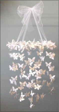 paper butterflies chandelier. this would be a great idea for a little girls room: