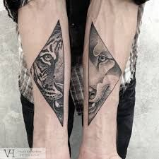 Resultado de imagem para tatuaje mitad geometrico tigre
