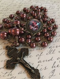 A personal favorite from my Etsy shop https://www.etsy.com/listing/248471050/new-chocolate-glass-pearls-rosary-cameo