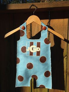 Announce The Big News With Painted Stuffed Burlap Pants From Mud Pie A Fun Centerpiece For The
