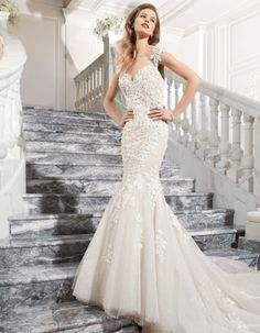 This sophisticated fit and flare, lace, and tulle wedding gown features sculpted lace cap sleeves transitioning into a magnificent illusion keyhole back with lace applique embellishment and a sweep train. Affordable Wedding Dresses, Wedding Dresses Photos, Used Wedding Dresses, Wedding Dress Styles, Designer Wedding Dresses, Tulle Wedding Gown, Tulle Gown, Mermaid Wedding, Bridal Gowns