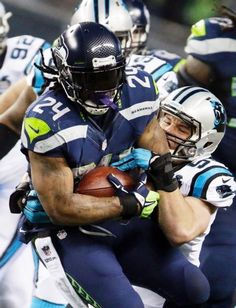 Seattle Seahawks running back Marshawn Lynch (24) runs against Carolina Panthers middle linebacker Luke Kuechly during the first half of an NFL divisional playoff football game in Seattle, Saturday, Jan. 10, 2015. (AP Photo/John Froschauer)