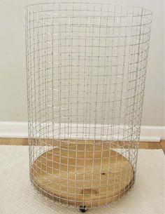 "Make a rolling wire laundry basket with a 15"" wood round and some hardware cloth. Add a cute canvas liner and you have a chic ""vintage"" hamper!"
