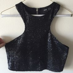 NWOT Sequined Black Crop Top ASOS Black Sequined Crop Top (never worn); razor back and front; super cute and wears well; skirt for sale in another listing ASOS Tops Crop Tops