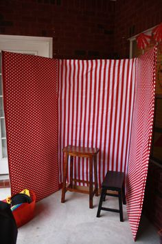 Photo booth made from refrigerator box and fabric or wrapping paper